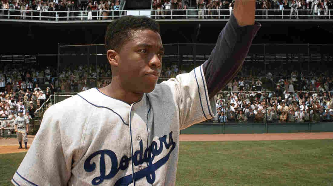 Brooklyn Dodgers first baseman Jackie Robinson (Chadwick Boseman) acknowledges the crowd in 42.