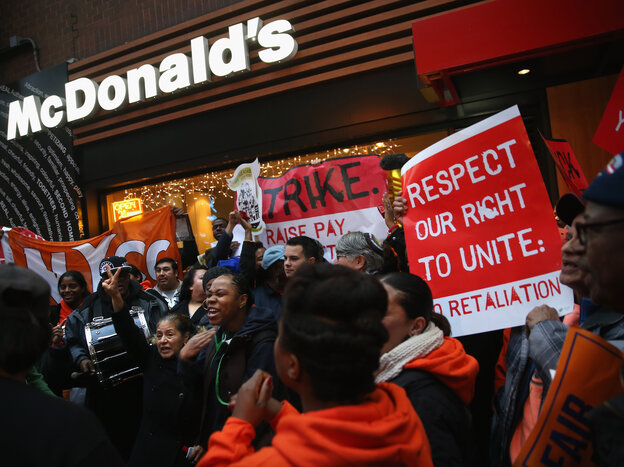 Protesters demonstrate at a McDonald's in New York on Dec. 5. Protesters staged events in cities nationwide, demanding a pay raise to $15 per hour for fas