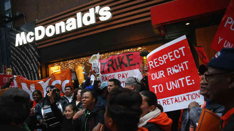 Protesters demonstrate at a McDonald's in New York on Dec. 5. Protesters staged events in cities nationwide, demanding a pay raise to $15 per hour for fast-food workers and the right for them to unionize.