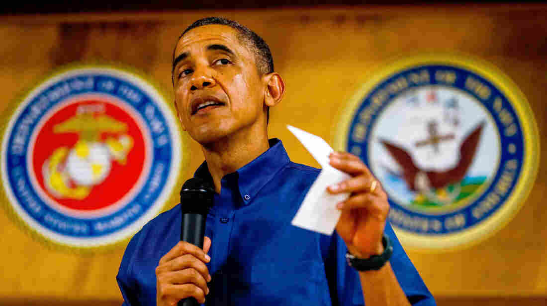 President Obama speaks to current and retired members of the U.S. military and their families as they eat a Christmas Day meal in the Anderson Hall mess hall at Marine Corps Base Hawaii on Wednesday.