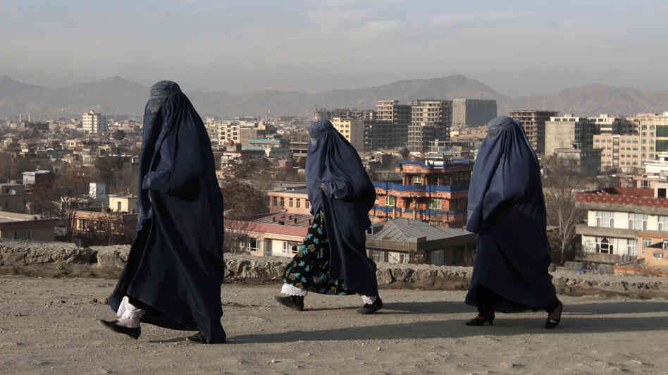 Women walk along on the street in Kabul, Afghanistan, last week. The country faces many changes next year, including a presidential election and the withdrawal of U.S. combat forces. There are also concerns that advances made by women over the past decade could be in jeopardy.