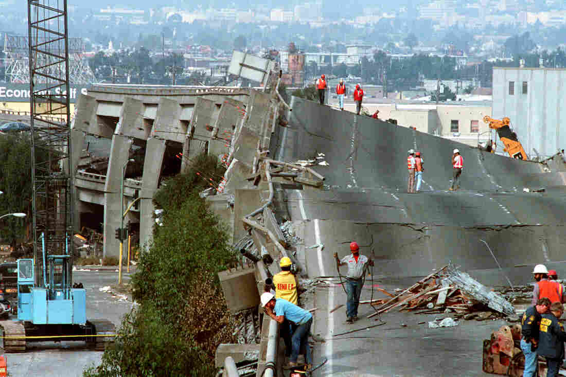 Workers in Oakland, Calif., check the damage to Interstate 880 on Oct. 19, 1989; this portion of the freeway had collapsed during the Loma Prieta earthquake two days earlier.