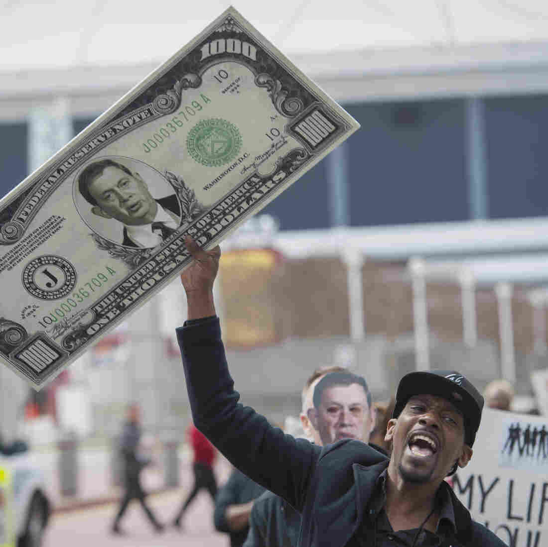 Timothy Webb and other advocates protest the cost of HIV drugs manufactured by the pharmaceutical company Gilead outside an AIDS conference in Atlanta in March. Gilead is making a new hepatitis C drug, Sovaldi.