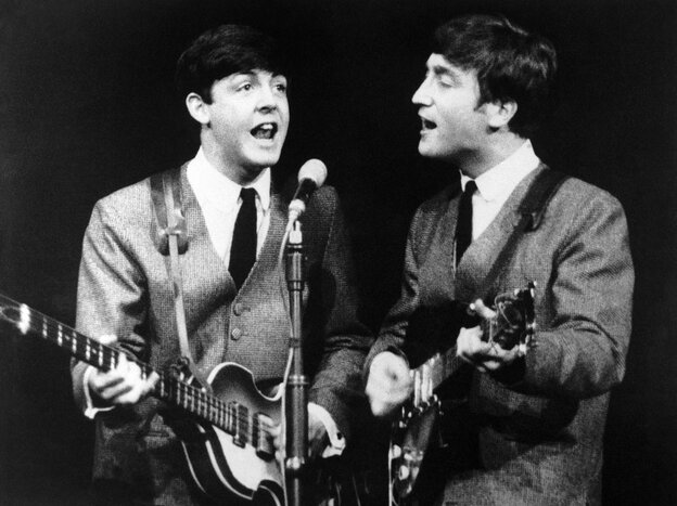 Paul McCartney, left, and John Lennon during a November 1963 Beatles show in London. The next month, the band had its first big hit in the U.S. and Beatlemania started to sweep America.