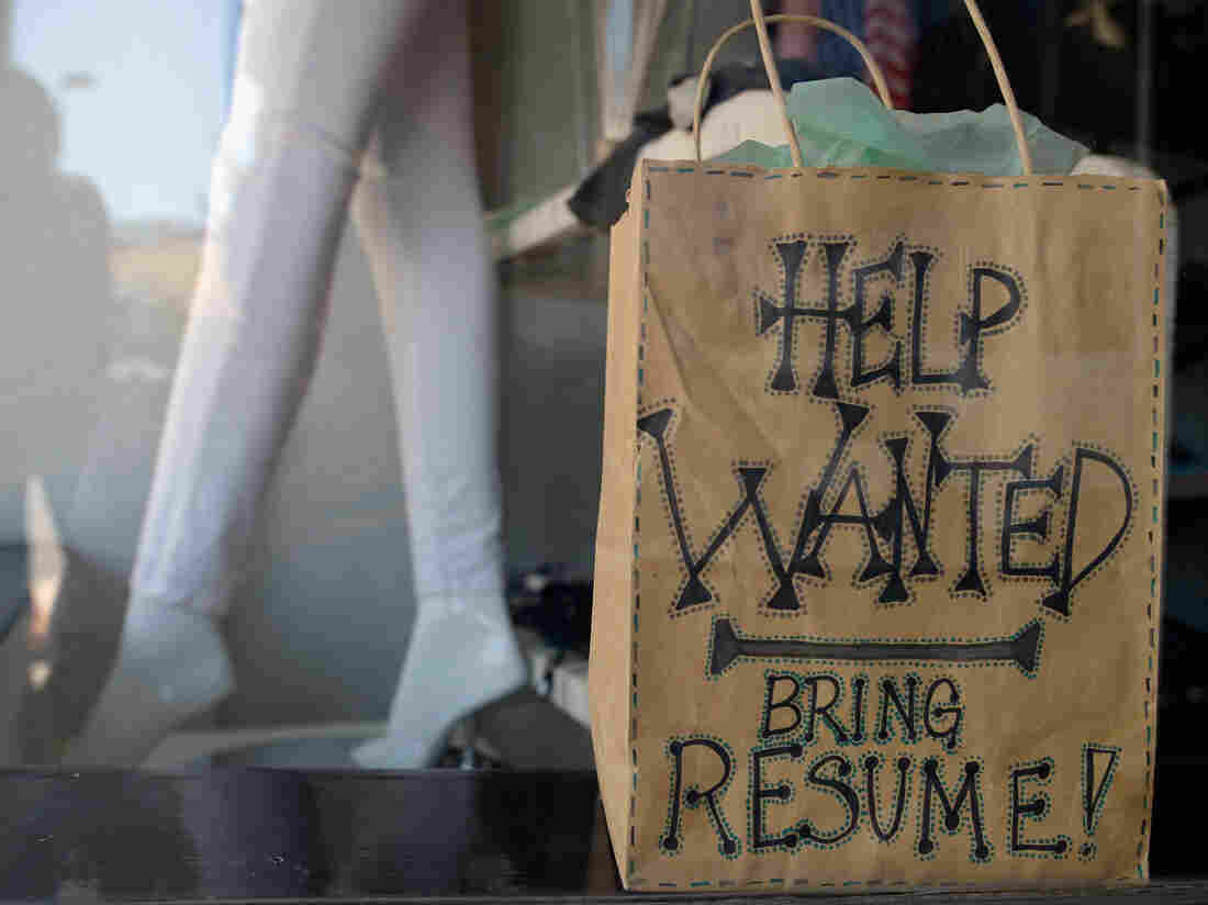 "A ""help wanted"" sign earlier this year in the window of a clothing store in Pasadena, Calif."