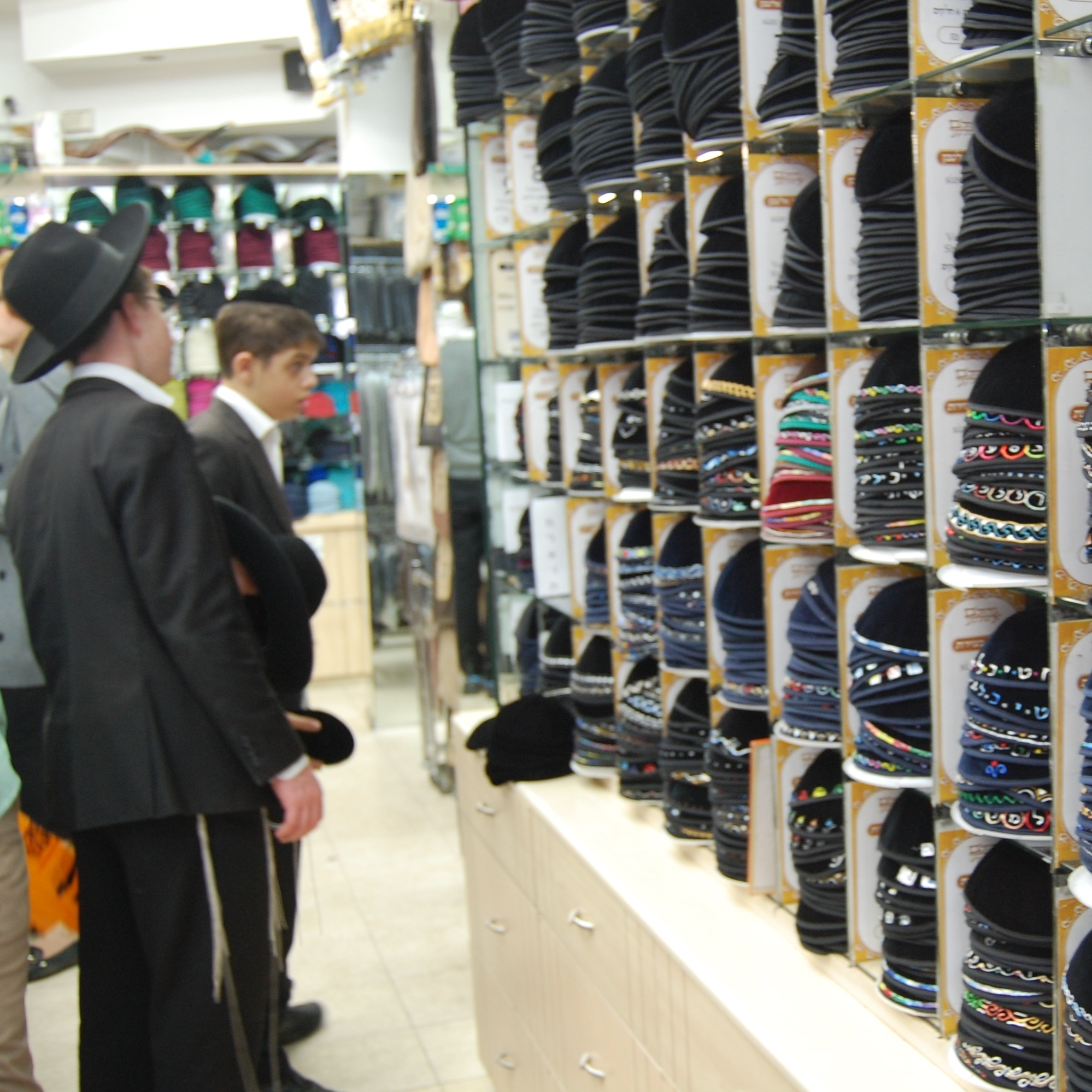 Jewish boys inspect the yarmulke collection -- from $5 to $15 -- at a shop in Jerusalem.