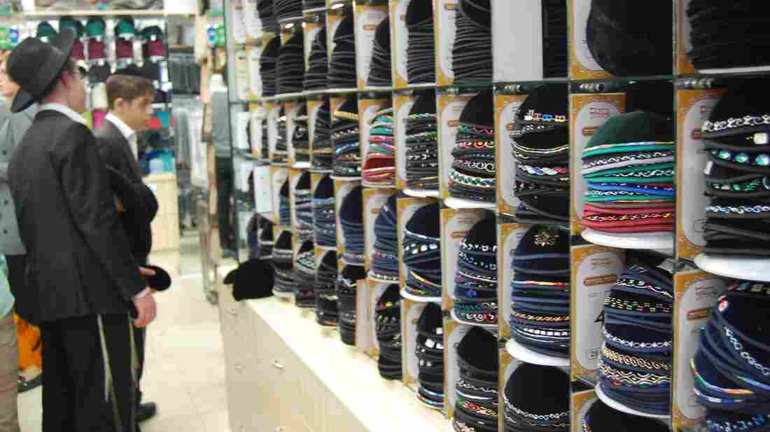 Jewish boys inspect the yarmulke collection — from $5 to $15 — at a shop in Jerusalem.