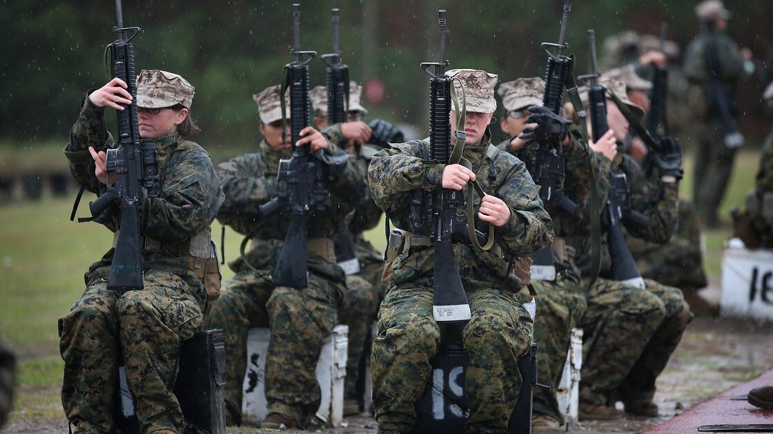 Female Marine recruits train on the rifle range during boot camp at Parris Island, S.C., on Feb. 25. The Marine Corps said it has postponed new physical standards that would require women to do three pullups, noting that many female recruits were not yet able to do so.