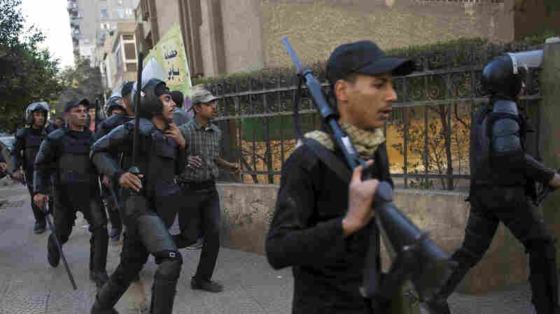 Egyptian riot police run after Muslim Brotherhood members after a demonstration in Cairo's eastern Nasr City district on Friday.