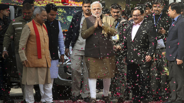 Gujarat Chief Minister Narendra Modi, who is the prime ministerial candidate of the opposition Bharatiya Janata Party, arrives at the party conference in New Delhi on Tuesday. Modi said Friday that the violence in Gujarat in 2002 shook him to the core. (AP)