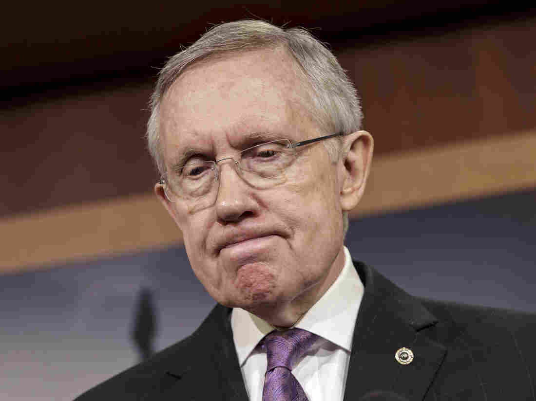 Senate Majority Leader Harry Reid (D-Nev.) talks to reporters at the Capitol in Washington, last Thursday. Reid has promised a vote no later than Jan. 7 on a measure to extend jobless benefits for three months.