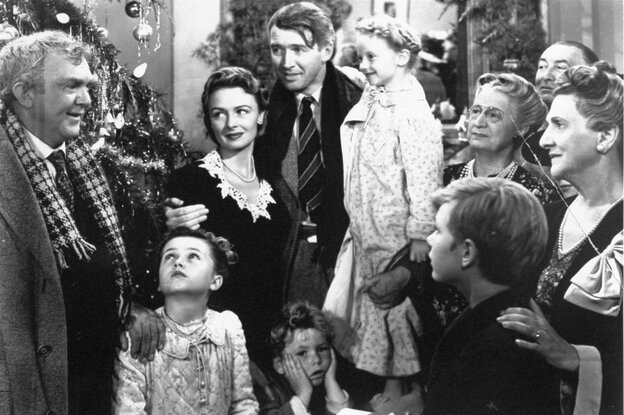 Worth living for: George Bailey, center, played by James Stewart, is reunited with his wife, Mary, played by Donna Reed, and his children in the final scene of Frank Capra's 1946 classic, It's A Wonderful Life.