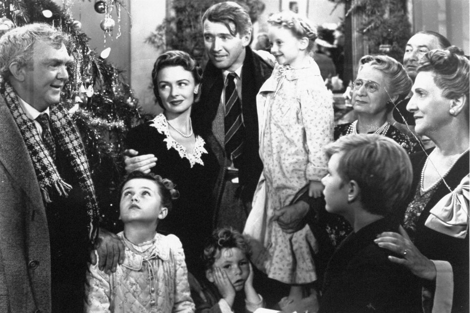 Worth living for: George Bailey, center, played by James Stewart, is reunited with his wife, Mary, played by Donna Reed, and his children in the final scene of Frank Capra's 1946 classic, <em>It's A Wonderful Life</em>. (AP)