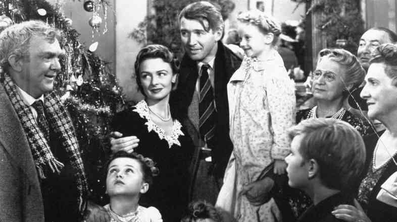 Worth living for: George Bailey, center, played by James Stewart, is reunited with his wife, Ma
