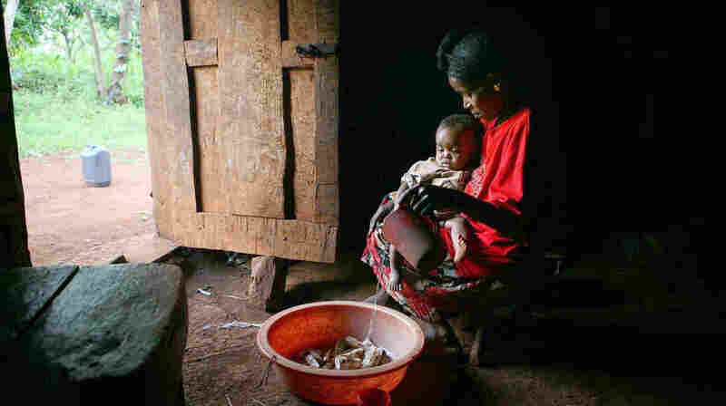 Almaz Acha sits with her baby Alentse at her home in the rural community of Sadoye, in southern Ethiopia. Families in rural communities, like this one, have benefited from Ethiopia's health extension program.