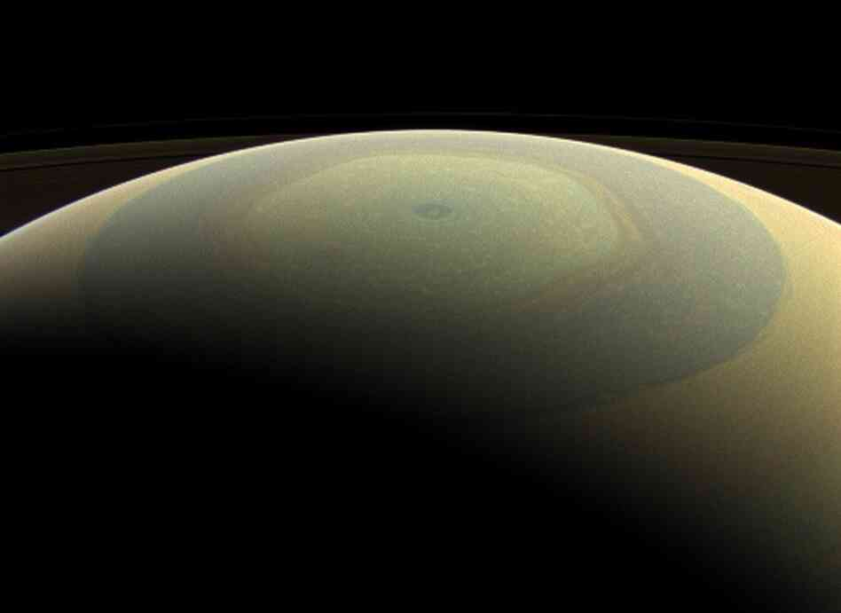 Saturn, looking something like a hand-painted ornament, in a newly re