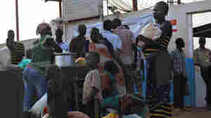 South Sudanese seek refuge at the United Nations compound in the capital, Juba, on Sunday. Though Juba is mostly peaceful now, growing numbers are seeking shelter at the compound in fear the ethnic killings will resume.