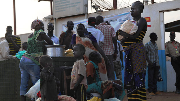 South Sudanese seek refuge at the United Nations compound in the capital, Juba, on Sunday. Though Juba is mostly peaceful now, growing numbers are seeking shelter a
