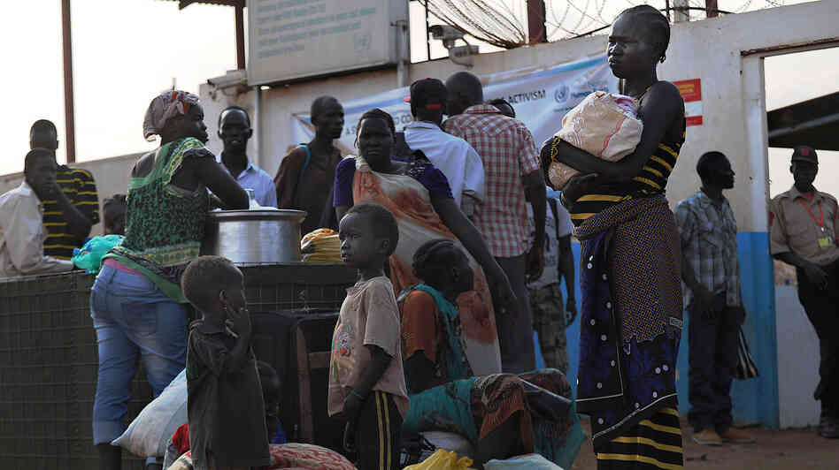 South Sudanese seek refuge at the United Nations compound in the capital, Juba, on Sunday. Though Juba is mostly peaceful now, growing numbers are seeking shelter at the compound in fear the eth
