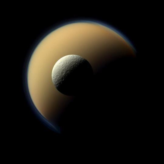 Rhea, Saturn's second-largest moon, seen in front of Titan.