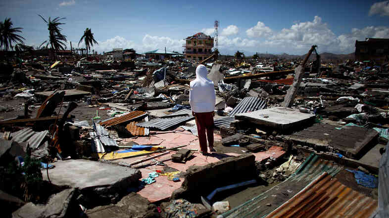 A boy stands in the ruins of the leveled a neighborhood in Tacloban. Food and water supplies were almost nonexsistent in the days immediately after the storm.