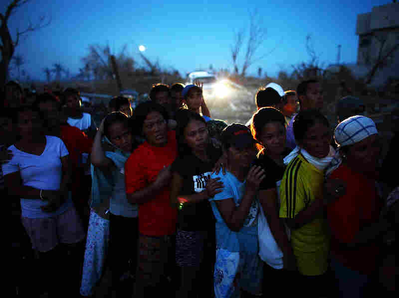 Filipino women stand in line for relief supplies being handed out by the United Nations High Commission for Refugees in Tacloban City.