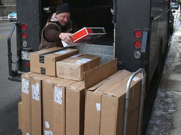 A UPS worker delivers packages Thursday in Chicago. Bad weather and a higher than expected demand from online sales caused FedEx and UPS to miss some Christmas delivery deadlines.