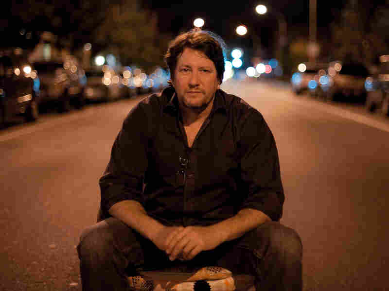 Photographer Chris Arnade found a chair in the middle of the road at 2 a.m., and sat in it for this self portrait.