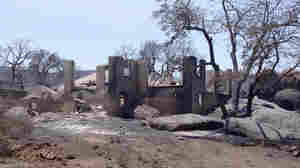 The wildfire in Yarnell, Ariz., last June destroyed homes and killed 19 firefighters. Experts say expansion into wildfire-prone areas has created new challenges for firefighters.