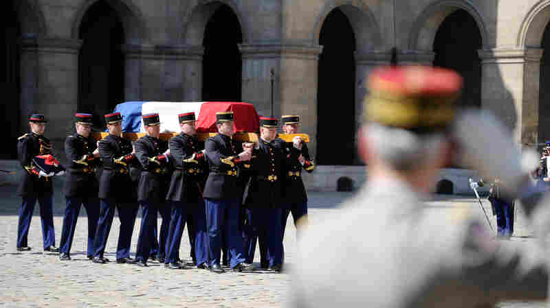 Pallbearers carry the flag-draped coffin of Francois Jacob, Nobel Prize-winner and World War II veteran, in Paris on April 24.