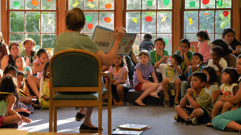 In Virginia this summer, Arlington Public Schools transported students in poor neighborhoods to community libraries for group readings. Studies say children from low-income families may hear roughly 30 million fewer words by age 3 than their more affluent peers.