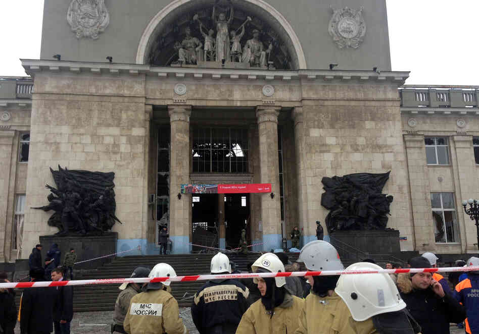 Russian firefighters and security personnel inspect the damage at a train station following a suicide attack in the Volga River city of Volgograd, Russia.