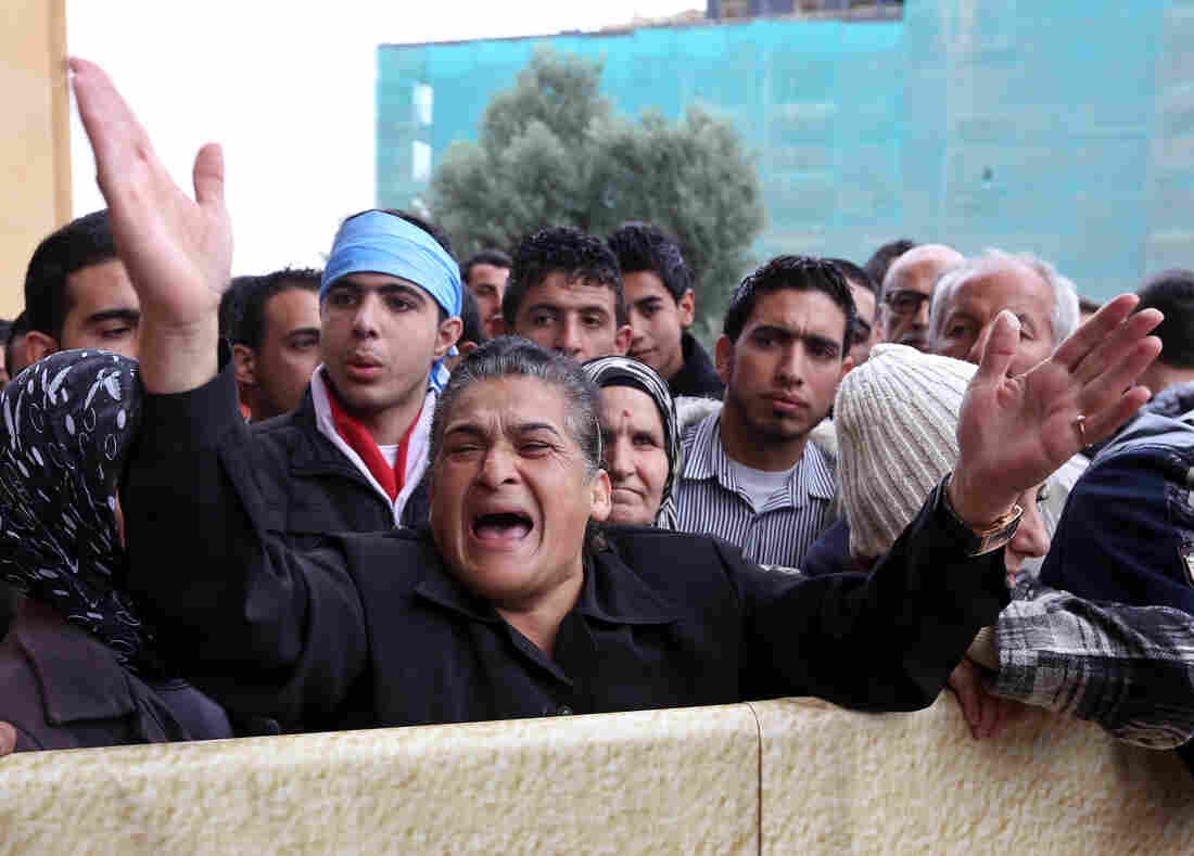A Lebanese woman chants slogans against Hezbollah leader Sheik Hassan Nasrallah, during the funeral of Mohamad Chatah, a senior aide to former Lebanese Prime Minister Saad Hariri, who was assassinated on Friday by a car bomb.