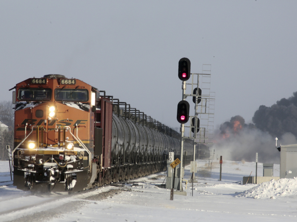 A plume of smoke rises from scene of a derailed train near Casselton, N.D., on Monday.