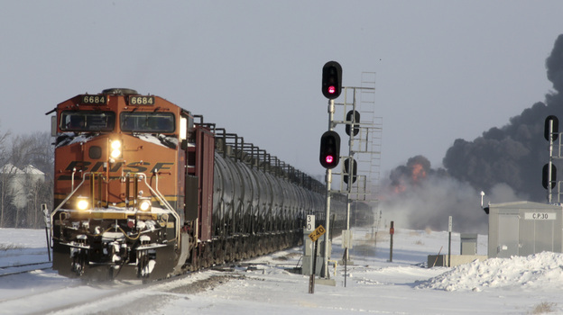 A plume of smoke rises from scene of a derailed train near Casselton, N.D., on Monday. (Reuters/Landov)