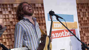 House musician Jonathan Coulton has a laugh while performing on Ask Me Another.