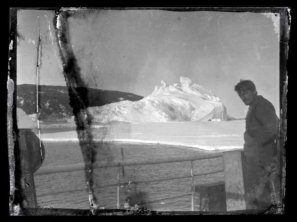Alexander Stevens, Shackleton's chief scientist, looks south from the deck of the Aurora. Hut Point Peninsula on Ross Island, Antarctica, can be seen in the background.