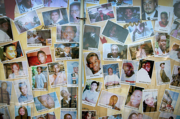 Pictures of Chicago residents who have died by gunfire are posted on the c
