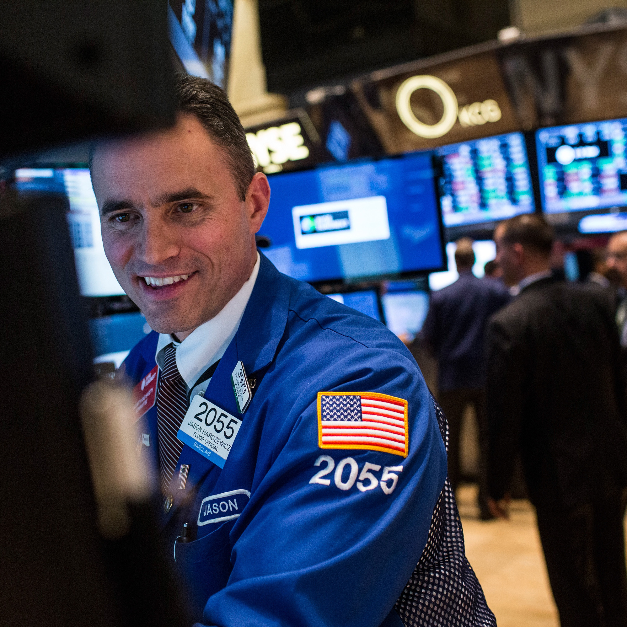 A trader works on the floor of the New York Stock Exchange in December. Economists are predicting that stock prices will continue to rise in 2014.