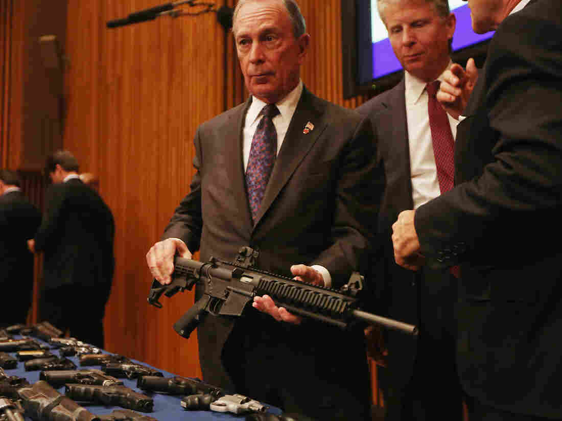 New York City Mayor Michael Bloomberg displays a confiscated AR-15 assault rifle in East Harlem as District Attorney Cy Vance (right) looks on during a news conference in October 2012 in New York City.