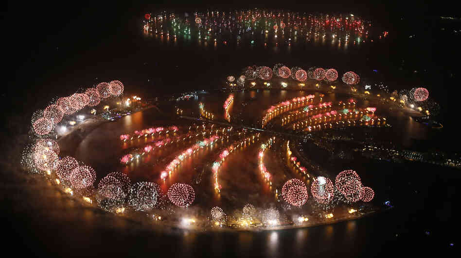 Fireworks explode over Palm Jumeirah in Dubai on Jan. 1, 2014, to celebrate the new year. Dubai's glittering fireworks d