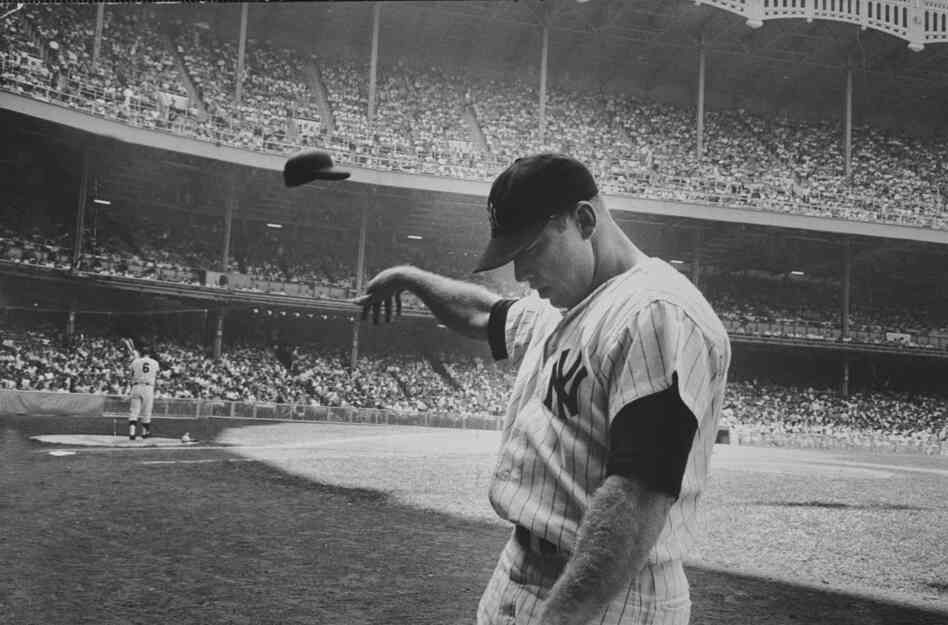 Yankee Mickey Mantle flinging his batting helmet away in disgust during bad day