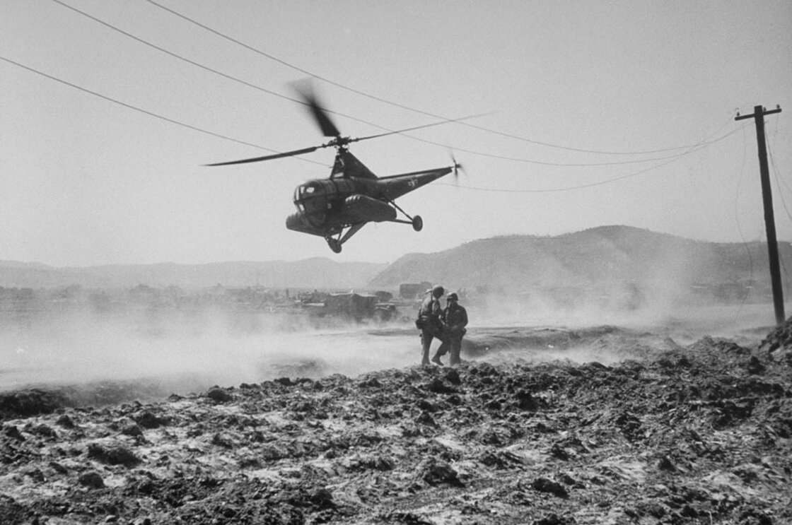 Helicopter ambulance taking off on a flight to Seoul, Korean War, March 1951