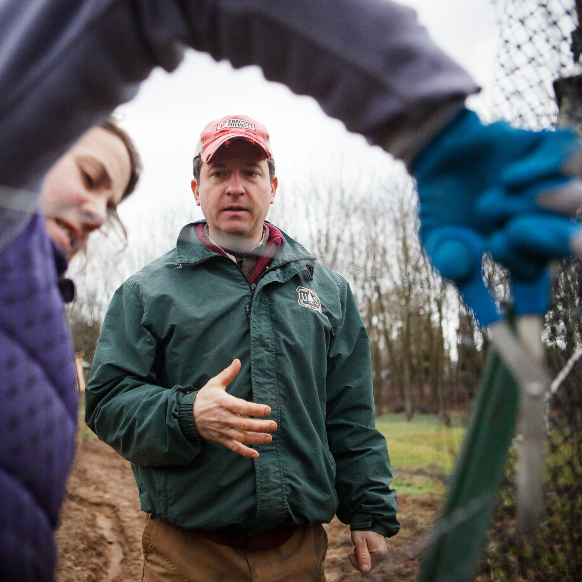 Chris Guerre and his wife, Sara, repair a fence at their farm in Great Falls, Va.