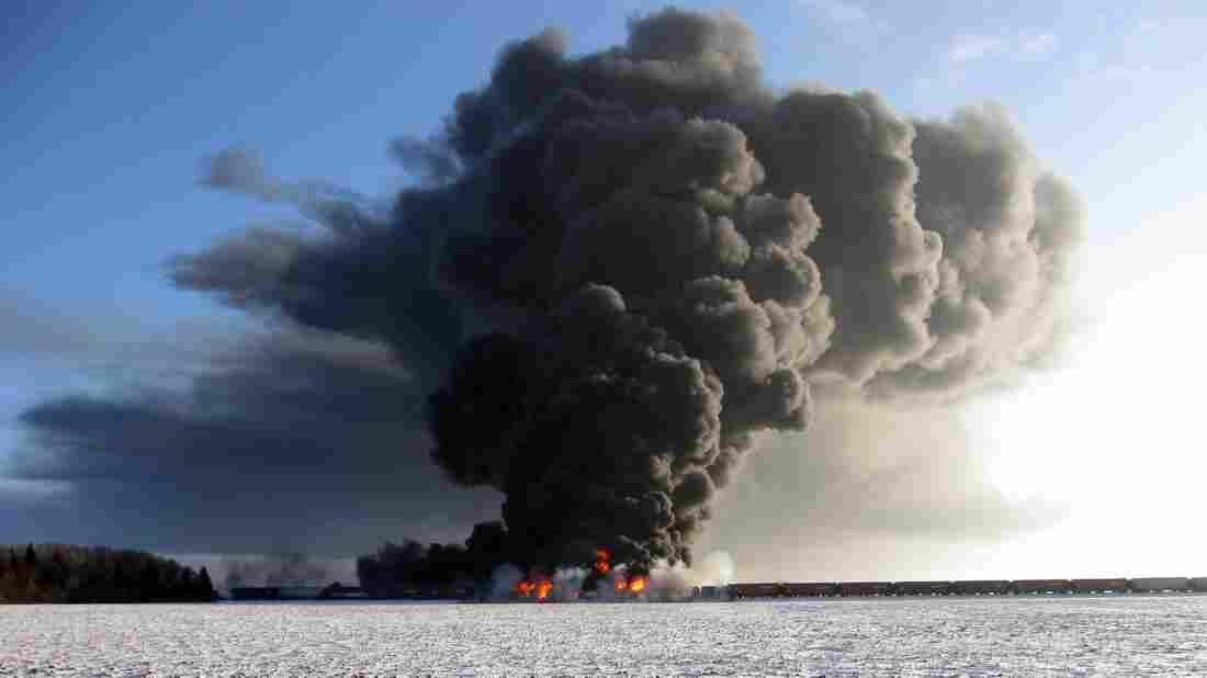 A fire burns  west of Casselton, N.D., Monday, after oil tanker cars exploded following a train derailment. No