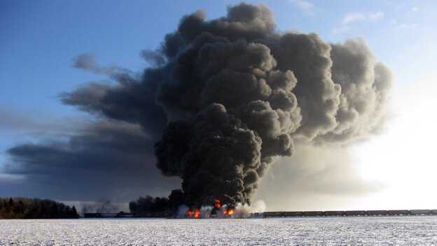 A fire burns  west of Casselton, N.D., Monday, after oil tanker cars exploded following a train derailment. No one has been reported hurt in the derailment or fire. But officials are recommending residents of the town to stay away from the potentially toxic smoke.