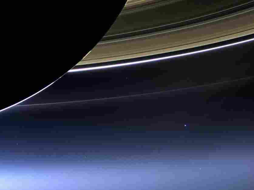In 2013, NASA's Cassini spacecraft captured this image of Earth from Saturn. Seen here, our planet is 898 million miles away (1.44 billion kilometers) and appears as a blue dot at center right.