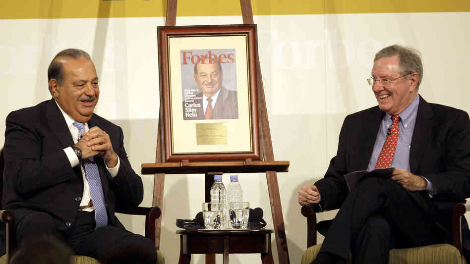 Carlos Slim Helu (left) talks with Steve Forbes of Forbes magazine. The magazine lists the Mexican telecom mogul as the world's richest man, with a net worth of $73 billion.
