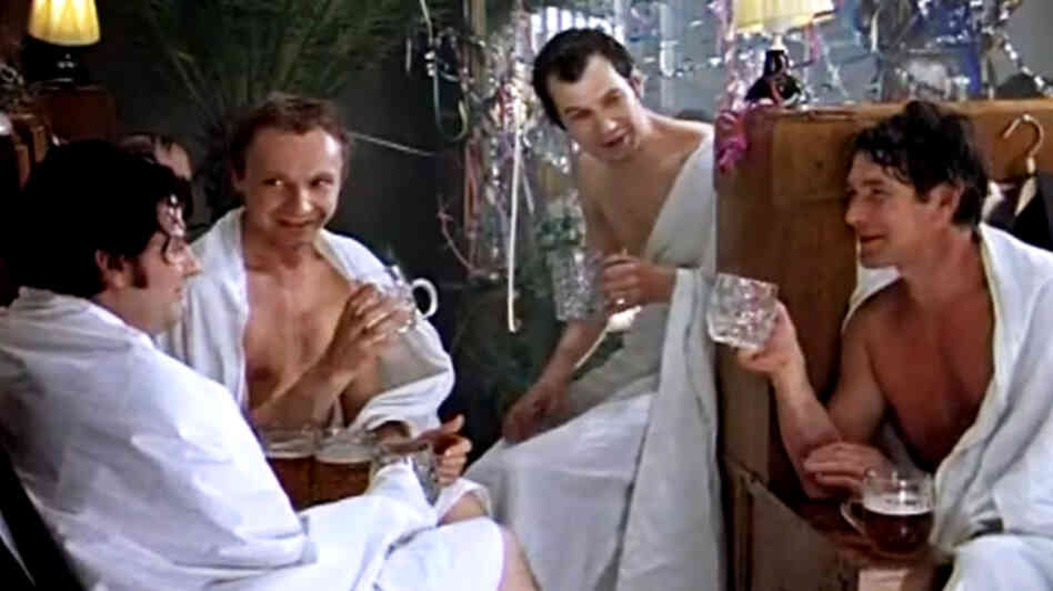 Zhenya drinks heavily with his friends at a Russian bathhouse in The Iro
