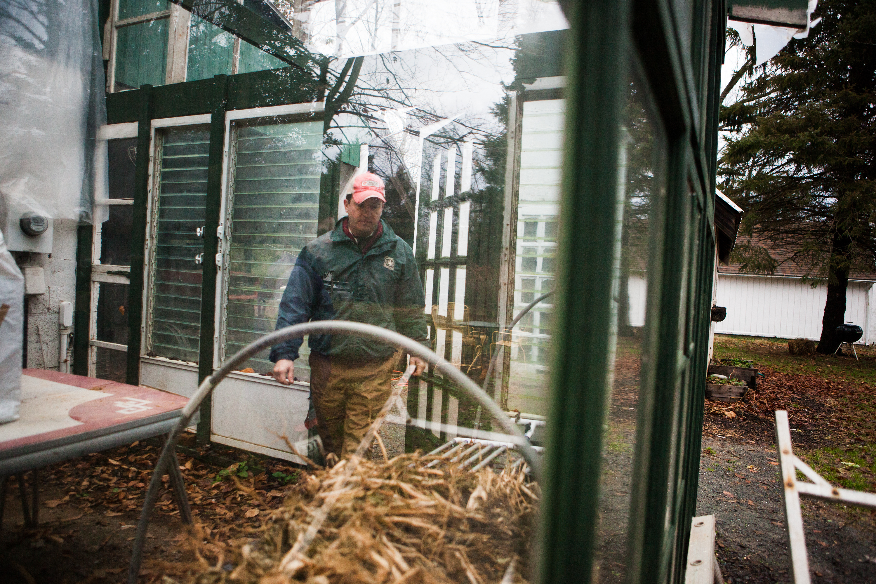 Guerre built this greenhouse out of recycled materials like old windows and doors.